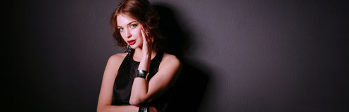 Beautiful woman with evening make-up in black dress.  Royalty Free Stock Photography