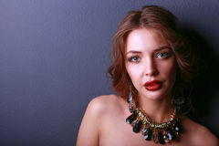 Beautiful woman with evening make-up in black dress Royalty Free Stock Photo
