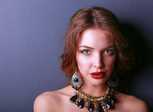 Beautiful woman with evening make-up in black dress Stock Image