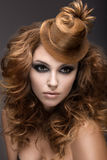Beautiful woman with evening make-up and hairstyle as a cap of hair. Beauty face. royalty free stock photo