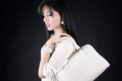Beautiful woman with evening make-up. Jewelry, bag and Beauty. Royalty Free Stock Photos