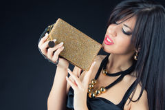 Beautiful woman with evening make-up. Jewelry, bag and Beauty. Stock Photos