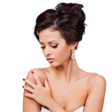 Beautiful woman with evening make-up. Jewelry and Beauty. Stock Photos