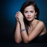 Beautiful woman with evening make-up. Jewelry and Beauty. Stock Photography