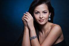 Beautiful woman with evening make-up. Jewelry and Beauty. Royalty Free Stock Image