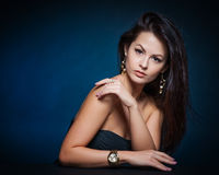 Beautiful woman with evening make-up. Jewelry and Beauty. Stock Image