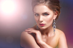 Beautiful woman with evening make-up. Jewelry and Beauty. Fashion photo Royalty Free Stock Photos