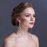 Beautiful woman with evening make-up. Jewelry and Beauty. Fashion photo Stock Photo