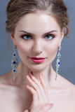 Beautiful woman with evening make-up. Jewelry and Beauty. Fashion photo Stock Photos