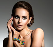 Beautiful woman with evening make-up jewelry. And beauty fashion photo royalty free stock image