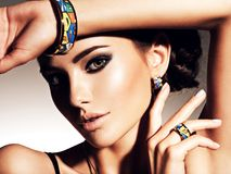 Beautiful woman with evening make-up jewelry Stock Photos