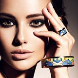 Beautiful woman with evening make-up jewelry Stock Photography