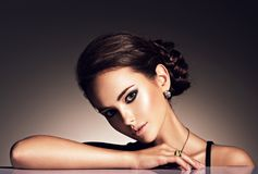 Beautiful woman with evening make-up jewelry Stock Image