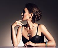 Beautiful woman with evening make-up jewelry Royalty Free Stock Images