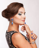 Beautiful woman with evening make-up. Jewelry and Beauty. Royalty Free Stock Photo