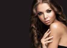 Beautiful woman with evening make-up and long Stock Image