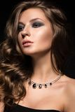 Beautiful woman with evening make-up and long Royalty Free Stock Image