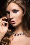 Beautiful woman with evening make-up and long Royalty Free Stock Images