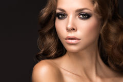 Beautiful woman with evening make-up and long straight hair . Smoky eyes. Fashion photo Royalty Free Stock Photography