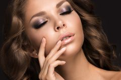 Beautiful woman with evening make-up and long straight hair . Smoky eyes. Fashion photo Stock Photos