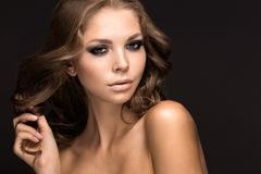 Beautiful woman with evening make-up and long straight hair . Smoky eyes. Fashion photo Stock Photo