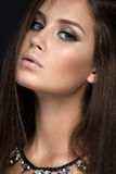 Beautiful woman with evening make-up and long Stock Photo