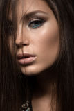 Beautiful woman with evening make-up and long Stock Images