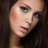 Beautiful woman with evening make-up and long Royalty Free Stock Photo