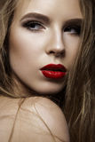 Beautiful woman with evening make-up and long straight hair . Smoky eyes. Fashion photo. Stock Images