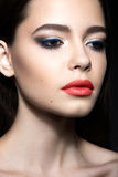 Beautiful woman with evening make-up, red lips. Beauty face. Royalty Free Stock Images