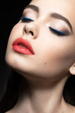Beautiful woman with evening make-up, red lips. Beauty face. Royalty Free Stock Photos