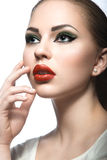 Beautiful woman with evening make-up, red lips. Beauty face. Stock Photo