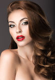 Beautiful woman with evening make-up, red lips and curls. Beauty face. royalty free stock images