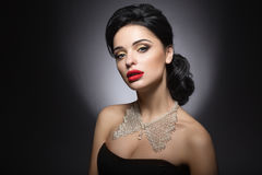 Beautiful woman with evening make-up, red lips and evening hairstyle. Beauty face. stock photo