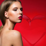 Beautiful woman with evening make-up, red lips and Stock Photography
