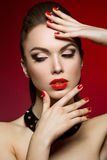 Beautiful woman with evening make-up and red nails Royalty Free Stock Photo