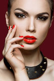 Beautiful woman with evening make-up and red nails Royalty Free Stock Photos