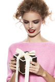 Beautiful woman with evening make-up takes box with present Royalty Free Stock Images