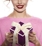 Beautiful woman with evening make-up takes box with present Stock Image