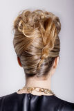 Beautiful woman with evening salon hairdo. Complicated hairstyle for party Royalty Free Stock Photography