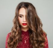 Beautiful Woman with Event Makeup and Long Healthy Wavy Hair Stock Photos
