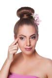 Beautiful woman examining her wrinkles Royalty Free Stock Image
