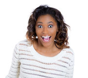 A beautiful woman excited and taken aback in surprise. Closeup portrait of a happy cute young beautiful woman looking shocked and surprised in disbelief, mouth Stock Photos