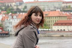 Beautiful woman on an excursion in Prague. Beautiful curly brunette woman on an excursion in Prague, Czech Republic Stock Images