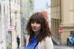 Beautiful woman on an excursion in Prague. Beautiful curly brunette woman on an excursion in Prague, Czech Republic Stock Photos