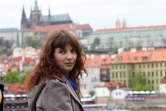 Beautiful woman on an excursion in Prague. Beautiful curly brunette woman on an excursion in Prague, Czech Republic Royalty Free Stock Photos
