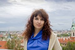 Beautiful woman on an excursion in Prague. Beautiful curly brunette woman on an excursion in Prague, Czech Republic Stock Photo