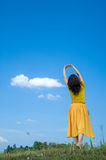 Beautiful woman exercise on blue sky Stock Photos