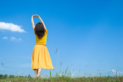 Beautiful woman exercise on blue sky Stock Photography
