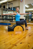Beautiful woman exercising on arc barrel Stock Images